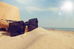 Beachside with square Sunglasses and beach hat